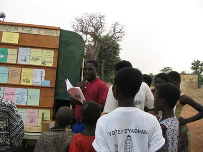 Picture - Reading and selling Nawdm books in a local market.JPG